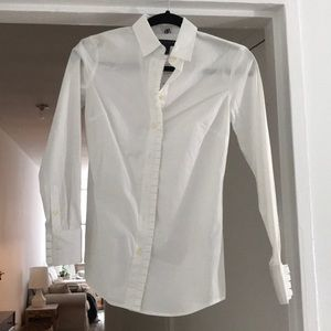 Brand new with tags. white button-up shirt!